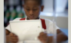 Boy with Tablet, photo credit: phys.org