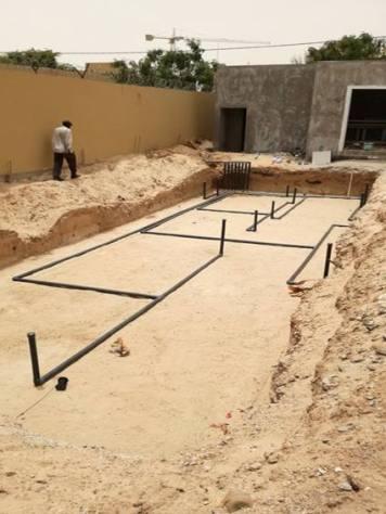 Pose des tuyaux radier piscine Nouakchott