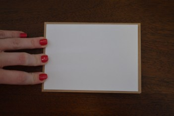 White cardstock resting on top of blank card
