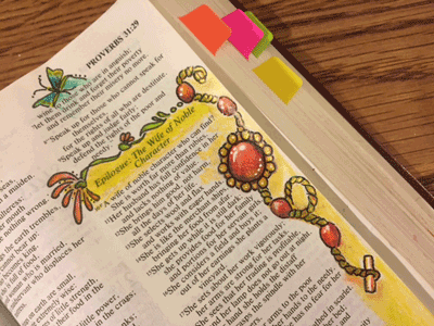 Photo of Bible page with Proverbs 31 illustrated.