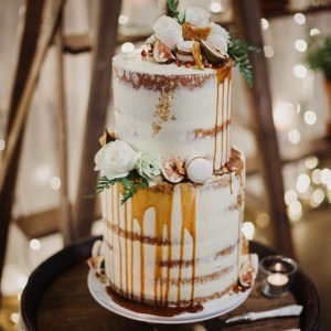 Tiered Wedding Cake with flowers and dripping sauce