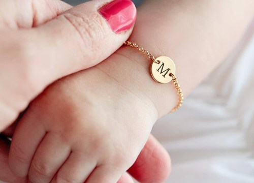 baby's hand with personalised bracelet for naming ceremony