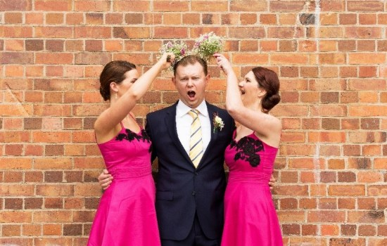 Fun wedding photo with groom and bridesmaids