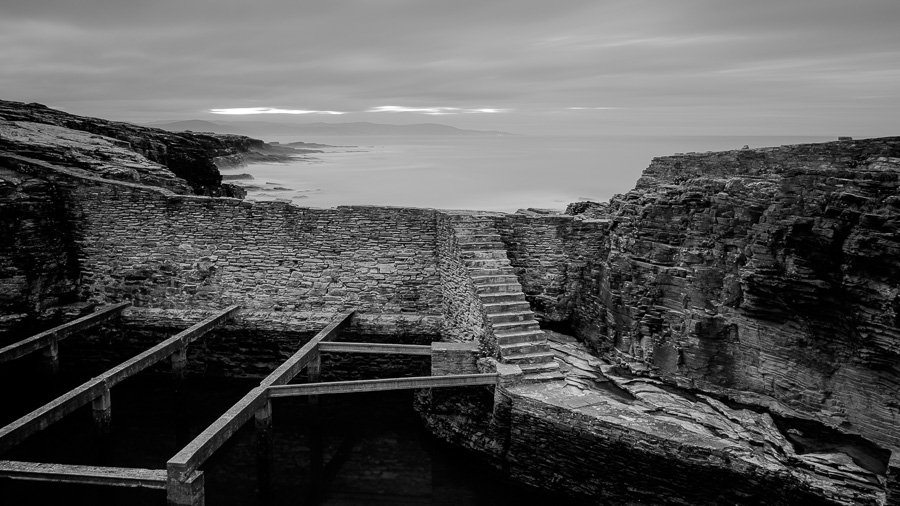 Black & white landscape photo of cetárea taken near Rinlo in Galicia, Spain.