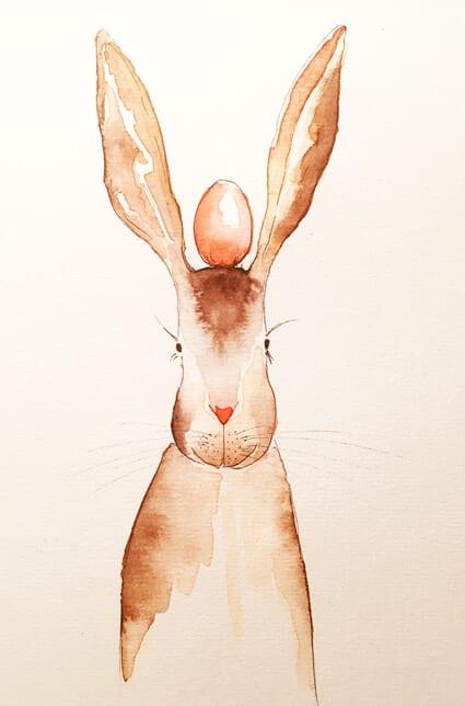Man sieht einen Osterhasen mit einem roten Ei auf dem Kopf balancierend. Ein Aquarell der Künstlerin Dodo Kresse