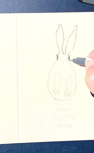 Man sieht eine Osterkarte, gemalt von Dodo Kresse für Creative Cl die Vorzeichnung mit Pigmentliner
