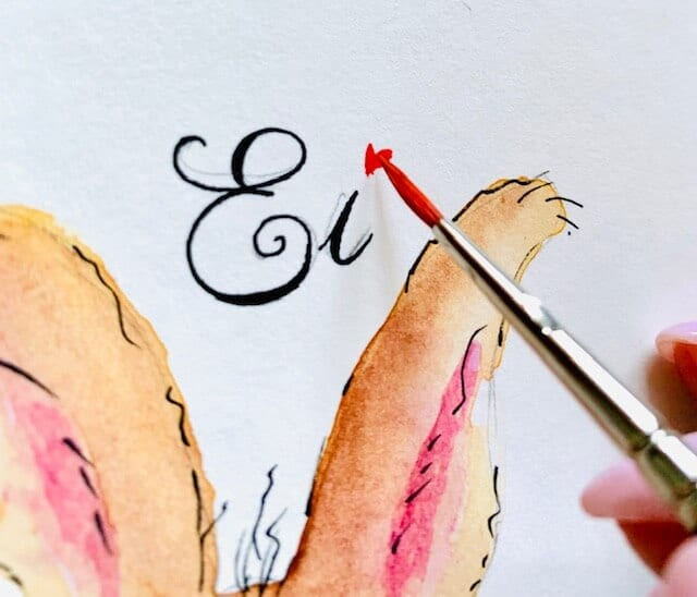 Und wieder eine Detail-Aufnahme vom Hand-Lettering, diesmal malt Dodo ein rotes Herz als I-Punkt auf die Osterkarte
