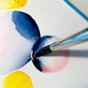 Hier siehst du zwei blaue Kreise mit einer Pinselspitze