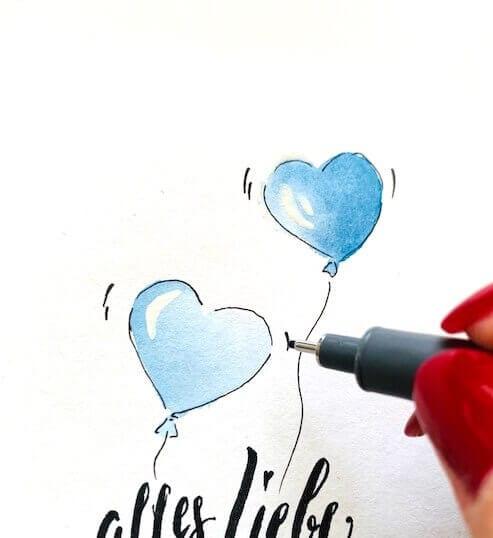 Die Luftballons, die auf diesem Bild zu sehen sind, sind himmelblau und bekommen ein paar Bewegungs-Streifen, die mit dem Fineliner gezeichnet werden.
