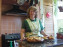picture of author with braided bread wreath and baskets of 'Easter bread'
