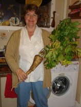 picture of author with parsnip including leafy top