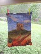 Felted wall hanging, drying against the backdrop of Coochin Hills, also in the Glasshouse Mountains. Size is now approximately 30 x 45 cm