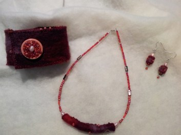 Jewellery made with hand-made felt roll, embroidery and beading.