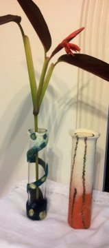 Two glass vases with the different styles of felted covering
