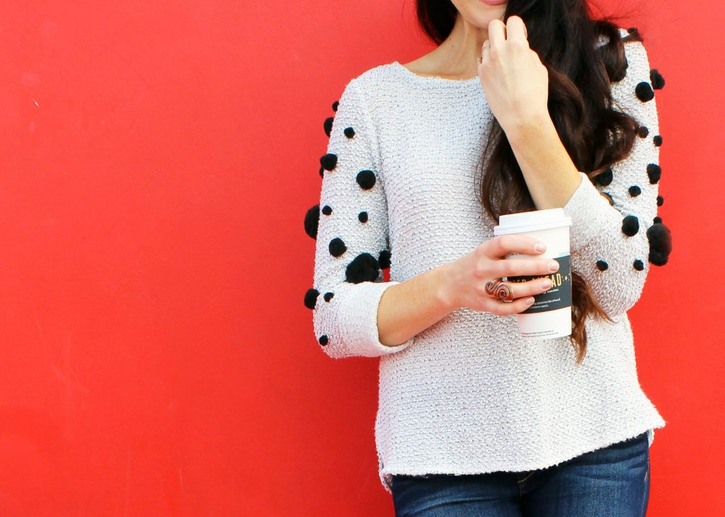 How to make a fun DIY pom pom sweater . A simple clothing refashion idea