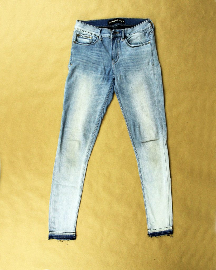 Before an Easy DIY upcycle jeans refashion tutorial. Use lace and paint to create a stencil