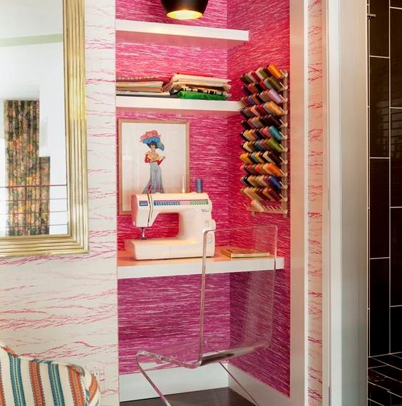 Small Space Big Style: Sewing space----Designer Molly Luetkemeyer transformed a tiny closet into a sewing space in the mezzanine of the Small Space Big Style design house in Hollywood. The walls are lined with contrasting pink grass cloth from Elitis. (Photo credit: John Ellis )