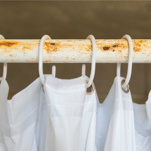 how to remove rust from a shower rod
