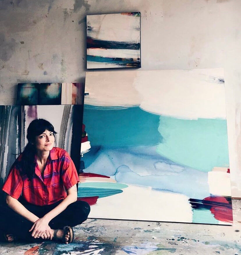 Eva Magill-Oliver with one of her paintings