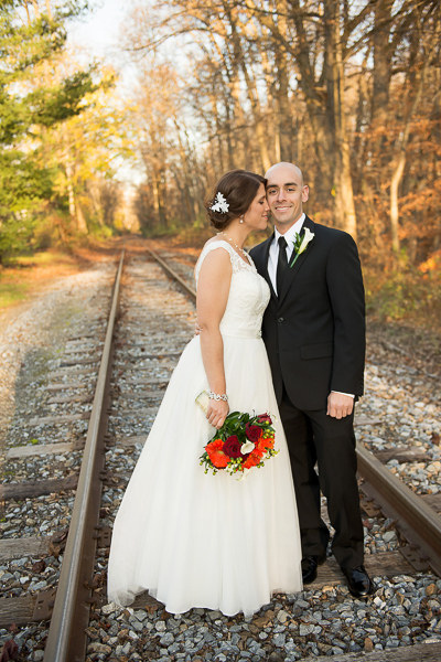 Full length of bride and groom on railroad tracks at Mendenhall Inn