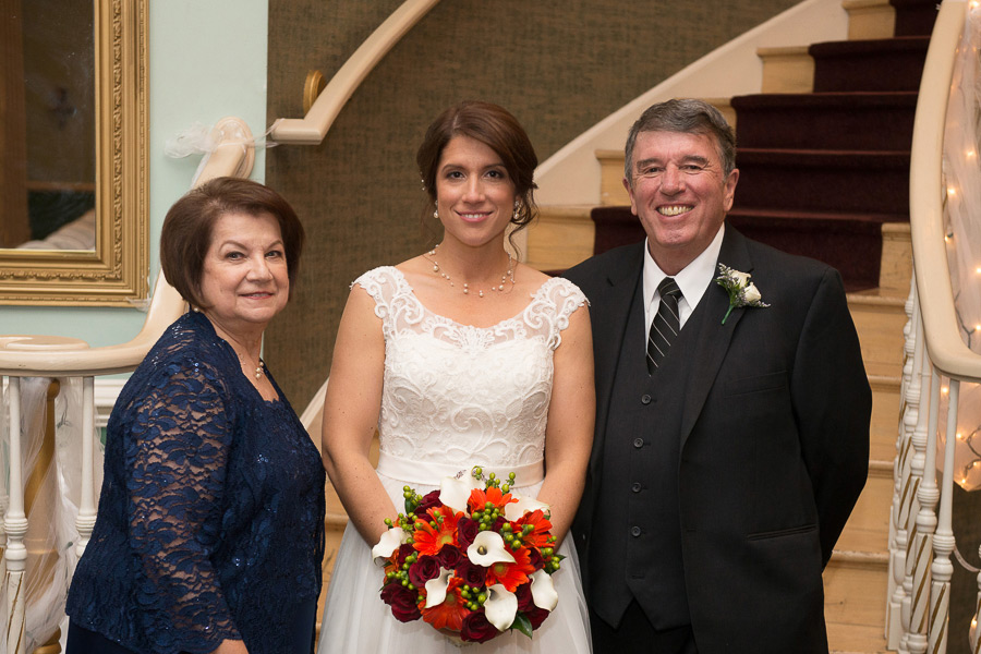 Formal shot of bride with her parents on Mendenhall Inn wedding day