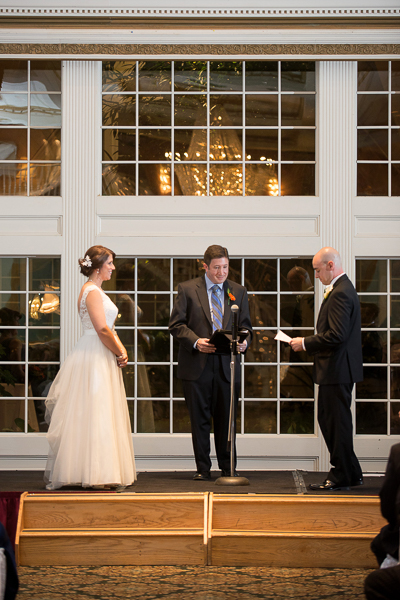 Groom reads vows to bride at Mendenhall Inn wedding ceremony