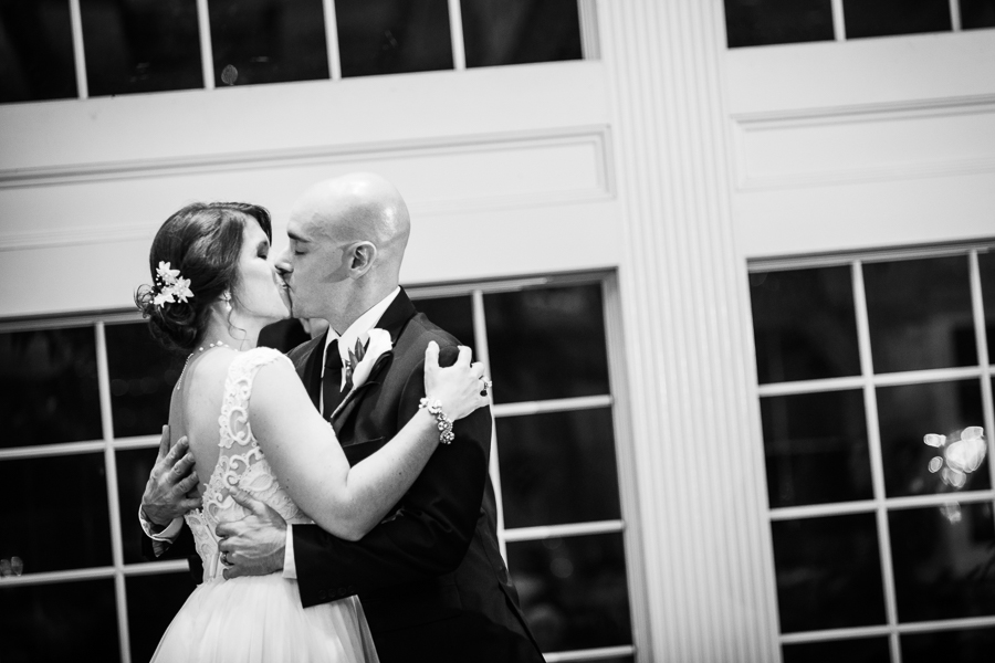 Bride and groom kiss at end of Mendenhall Inn wedding ceremony