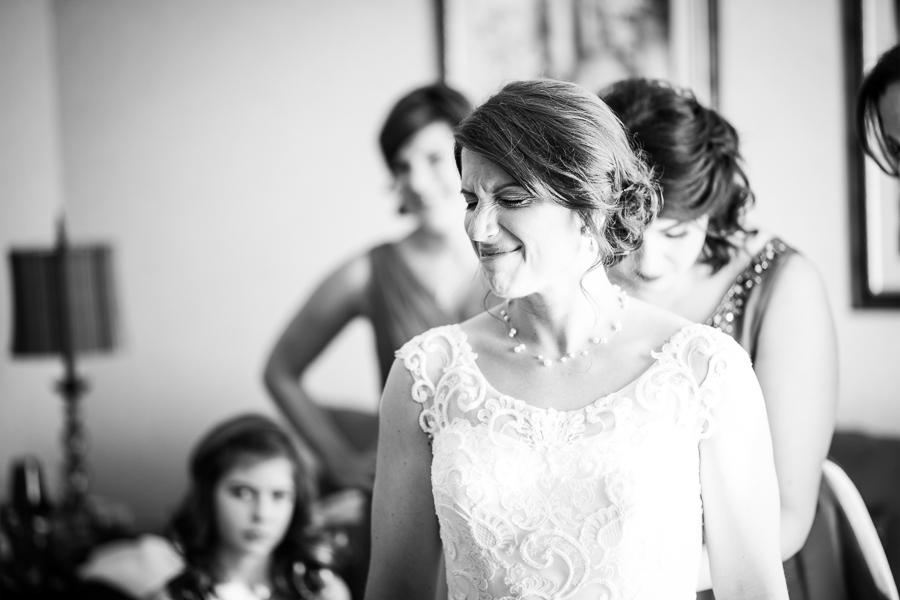 Bride makes a funny face while getting ready in one of Mendenhall Inn's guest rooms