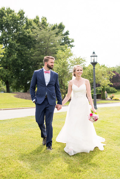 Couple walks hand in hand on the lawn of the Hilton Christiana