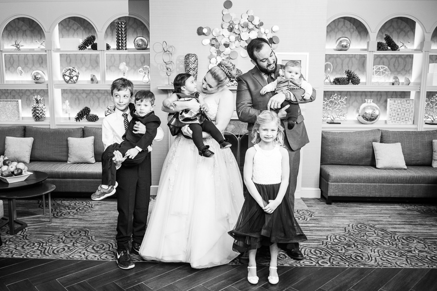 Couple poses with 5 nieces and nephews in club room