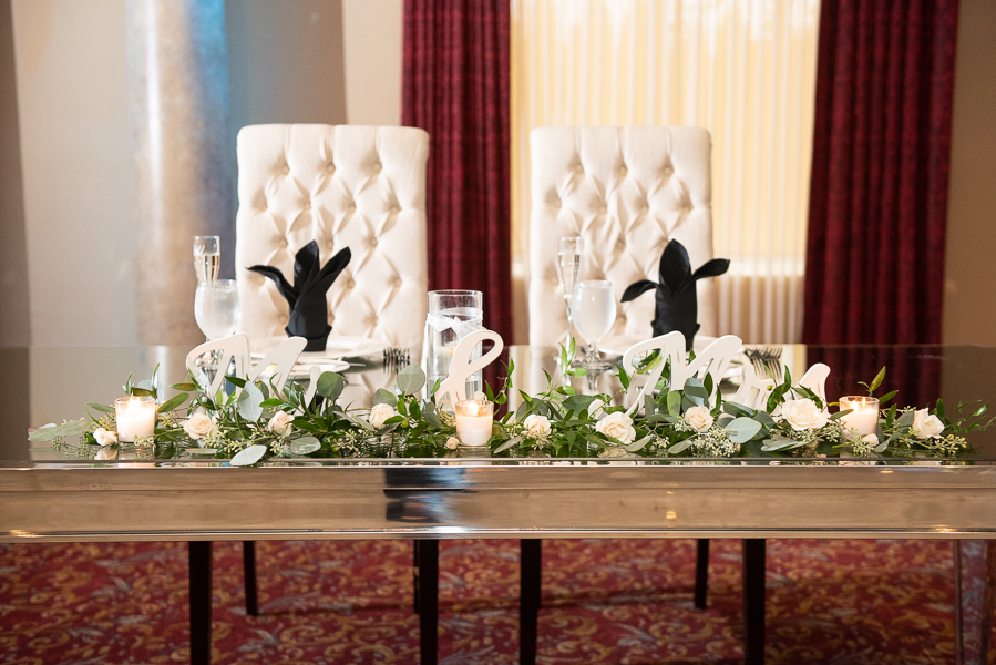 Sweetheart table with fancy chairs at Waterfall wedding