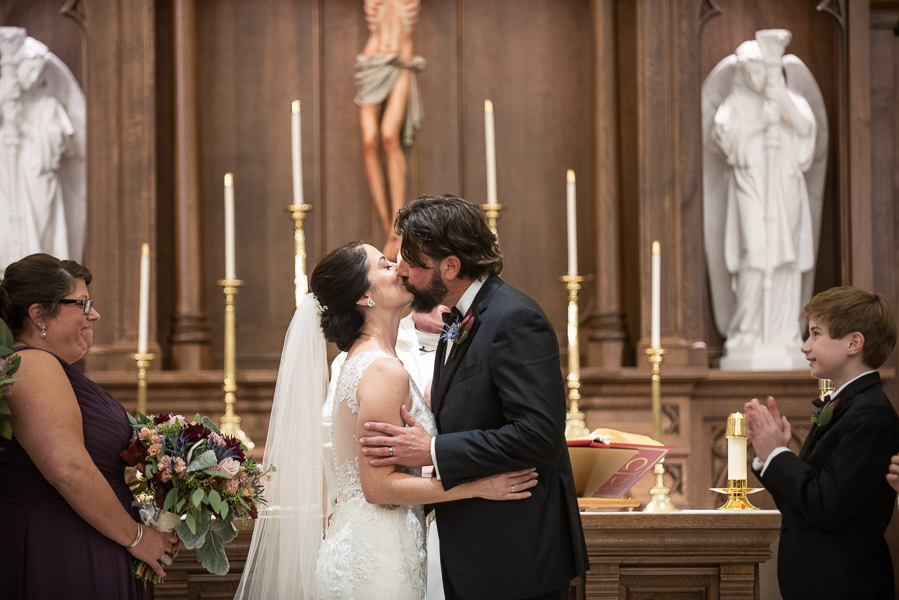 Wedding couple share their first kiss as husband and wife