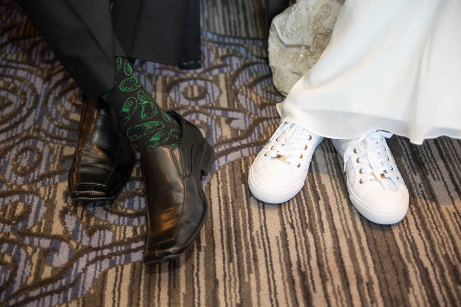 Close up of the bride and groom's shoes