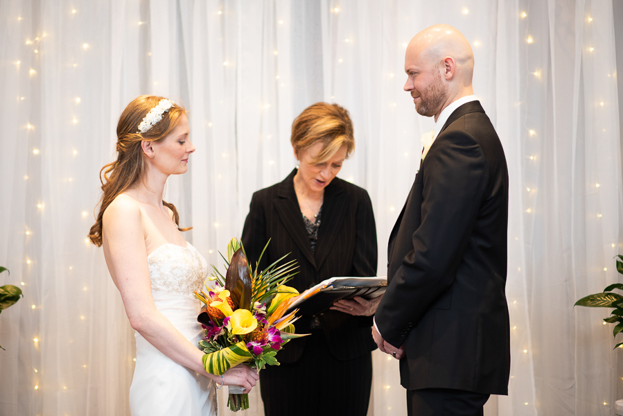 Indoor ceremony photo of bride and groom at Hilton Christiana wedding