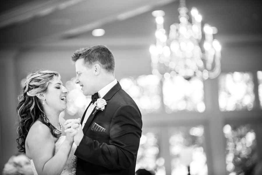 Black and white image of the bride and groom's first dance in Deerfield ballroom