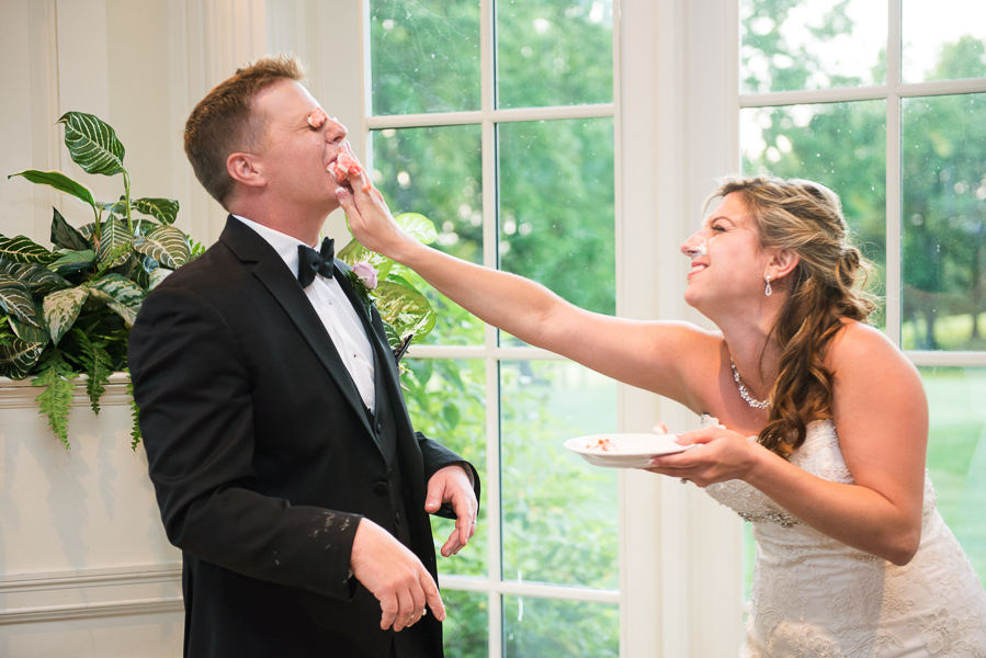 Bride shoves cake into groom's mouth at Deerfield wedding