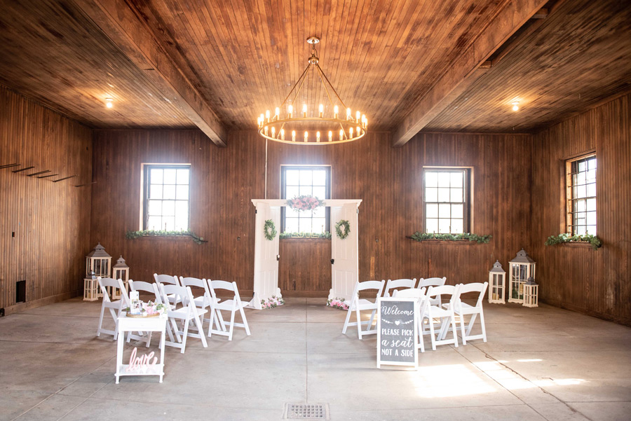 Carriage House decorated for a Whist Club wedding ceremony with white shutter doors where the bride and groom will stand