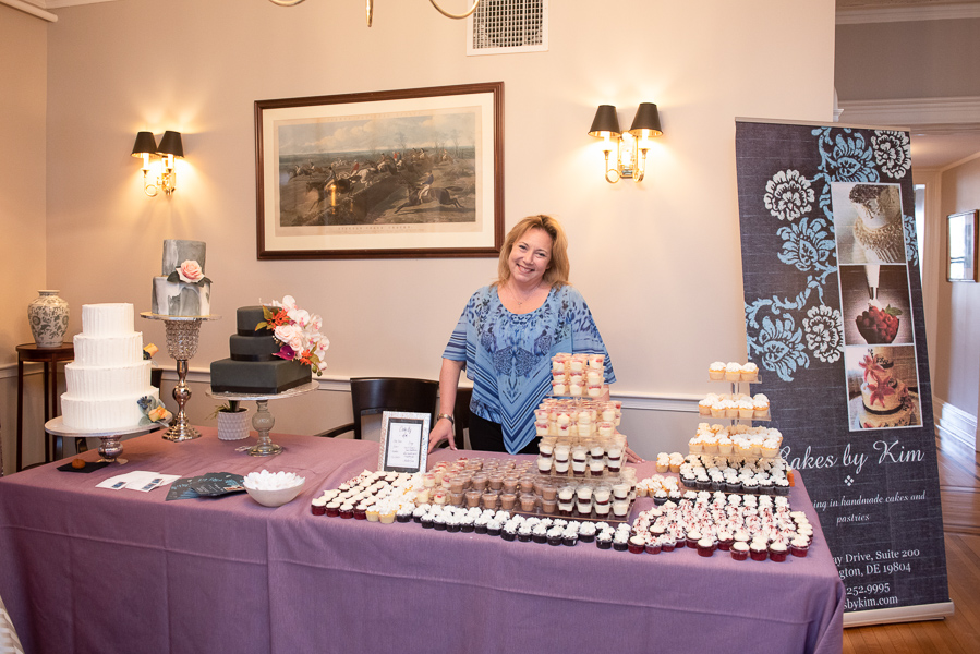 Cakes by Kim table at wedding show