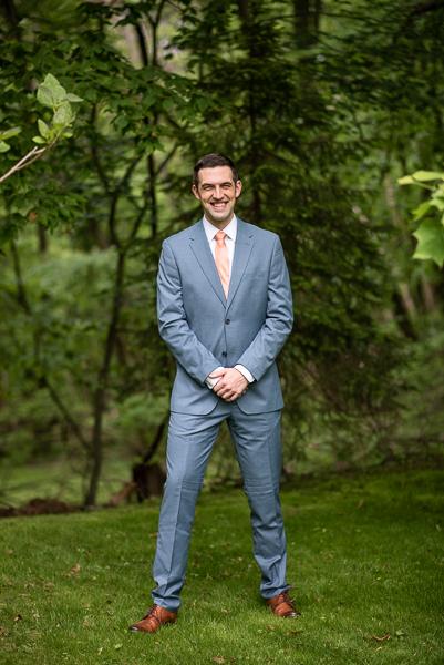 Groom poses before wedding