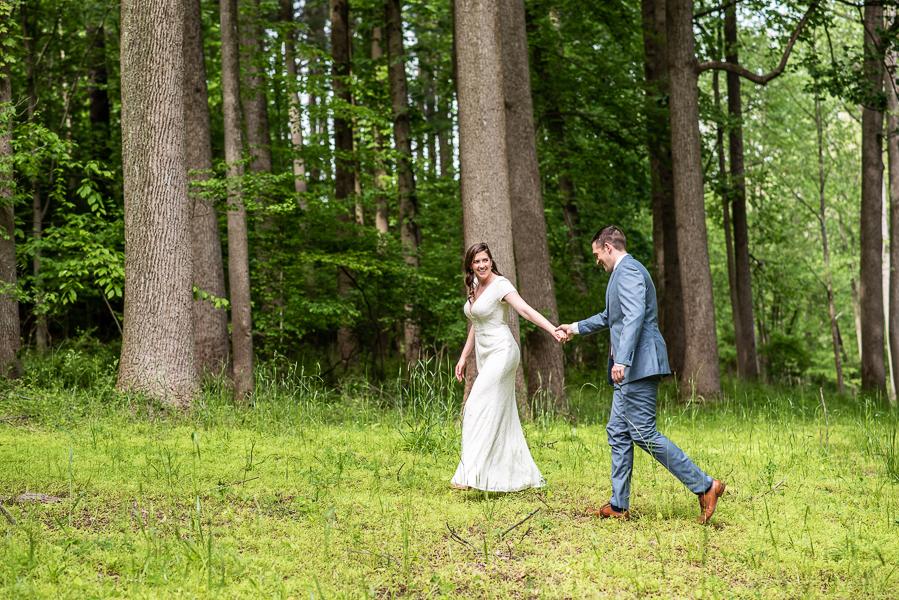 Bride and groom walking before intimate Delaware wedding