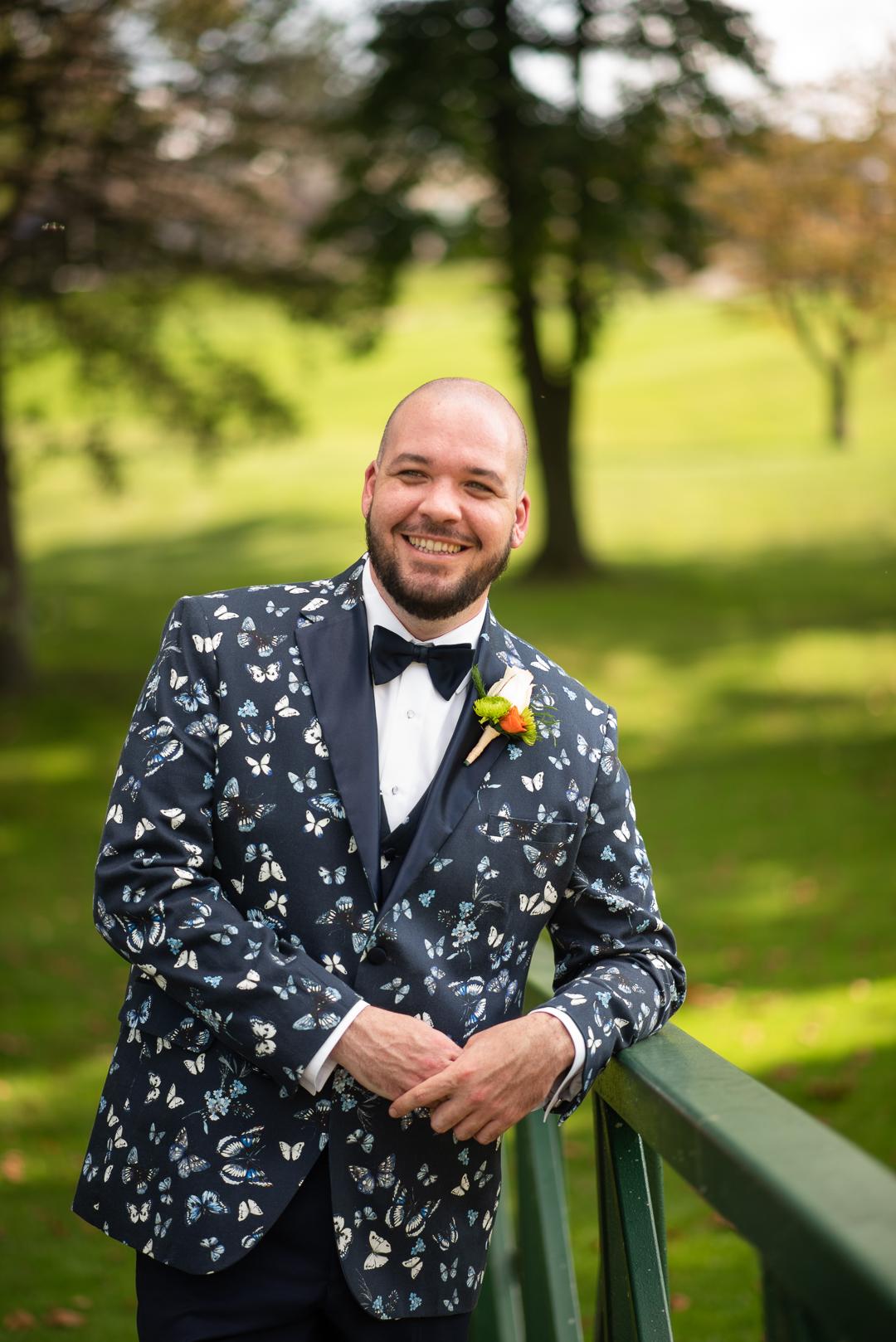 groom in printed tux