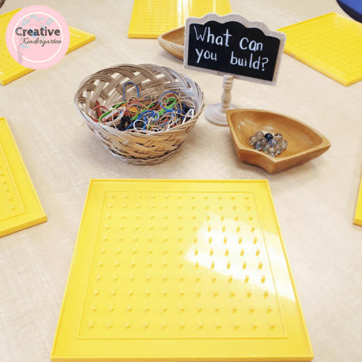 geoboard and marble provocation for kindergarten. challenge students to build something with elastics and marble, or ask them to make a maze