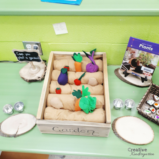 Small world vegetable garden play center for kindergarten. Felt vegetables and rocks to learn about plants.