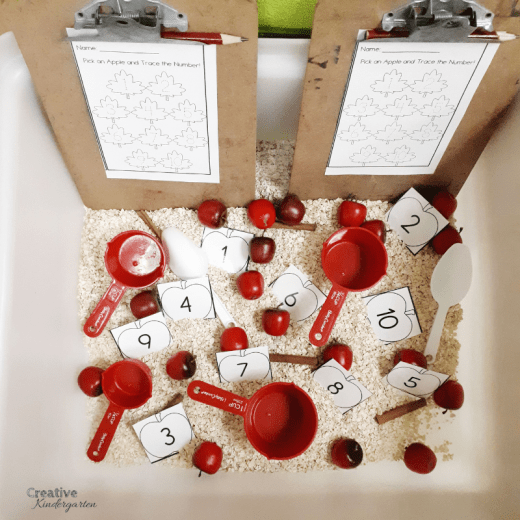 Apple themed sensory bin for fall. Work on number recognition and number formation skills with the number set sheets.