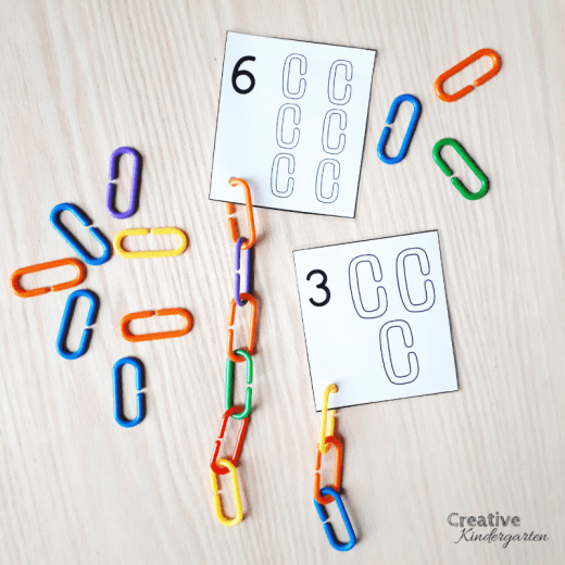 Use math manipulatives like links to practice counting, 1:1 correspondence, and number formations.