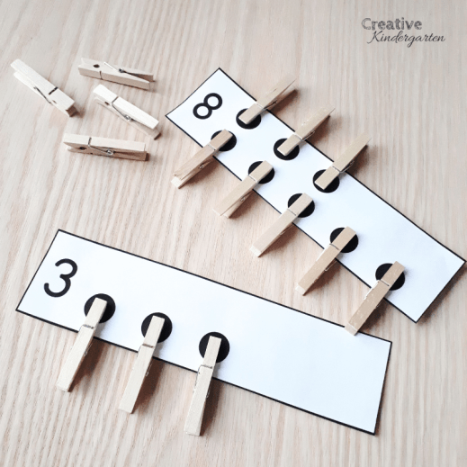 Use hands-on materials like clothespins to practice counting, 1:1 correspondence, and number formations.