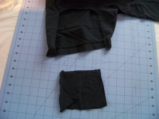 Cut out a square from one of the t-shirt arms.