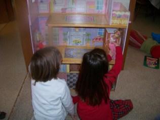 Kaylin and Karis playing with their new house Chrismas morning, 2011