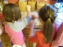 Kaylin and Karis cutting out biscuits.
