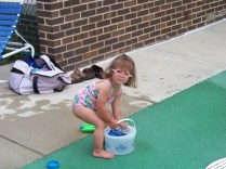 Kiley will only play in the water if she has a bucket.